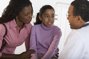 Mother and daughter talking with healthcare provider