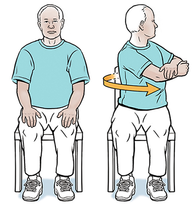 Man sitting in chair with hands on knees. Man sitting in chair doing seated rotation exercise.