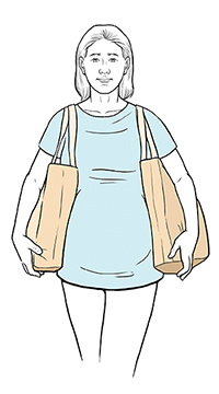 Pregnant woman carrying bags safely.