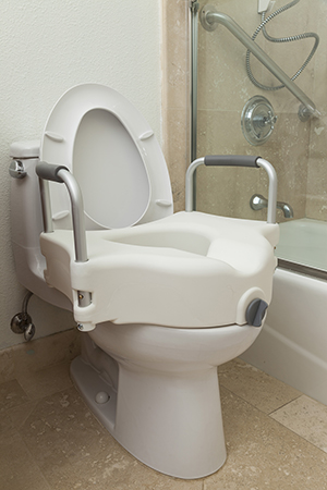 Commode seat on toilet.