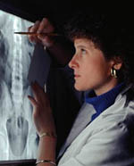 Picture of a female radiologist reading an x-ray